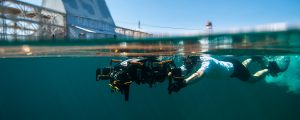 Picture of San Diego City Community College student testing underwater technology at the Transducer Evaluation Center